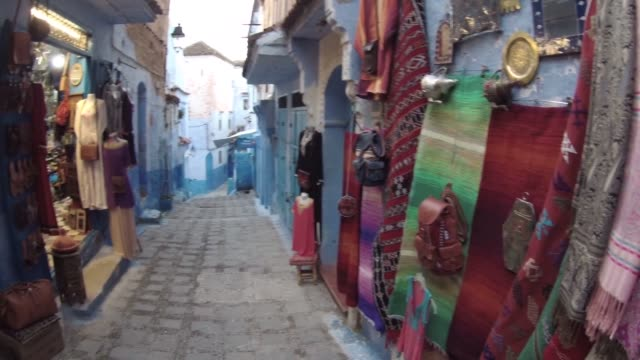 sale of handicrafts in the streets of chechaouen, in morocco - souk video stock e b–roll