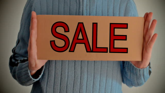 Sale Sale message on cardboard free stock without watermark stock videos & royalty-free footage