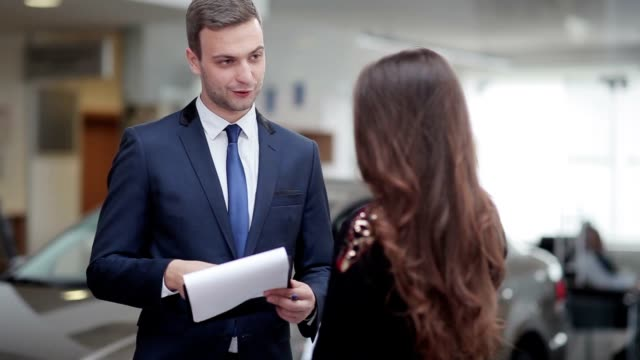 Salesman explaining contract conditions to woman