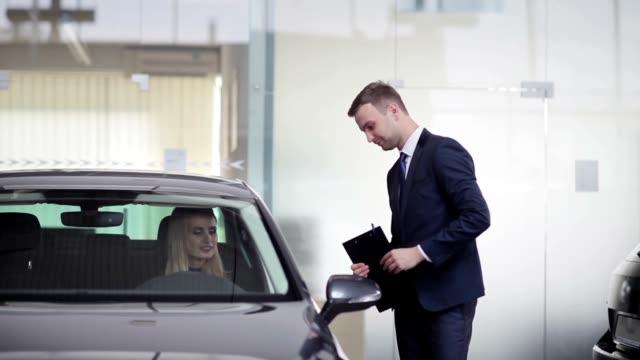 Salesman helping a buyer