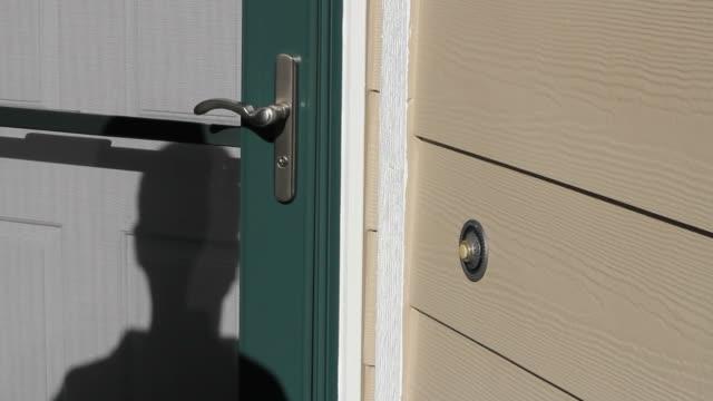 Salesman Ringing Front Doorbell video