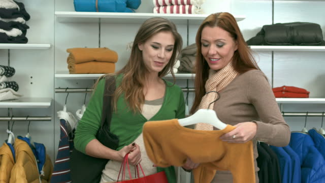 HD: Saleswoman Assisting Customer In Boutique video