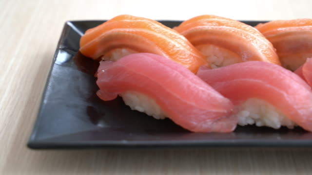 salmon and tuna sushi salmon and tuna sushi tuna seafood stock videos & royalty-free footage