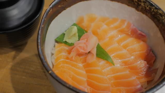 Salmon Donburi Fresh salmon sashimi on vinegared rice. video