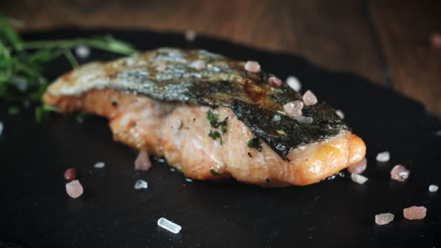 salmon fish fillet cooked and served with lemon - seafood stock videos and b-roll footage