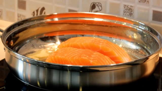 Salmon frying in pan video