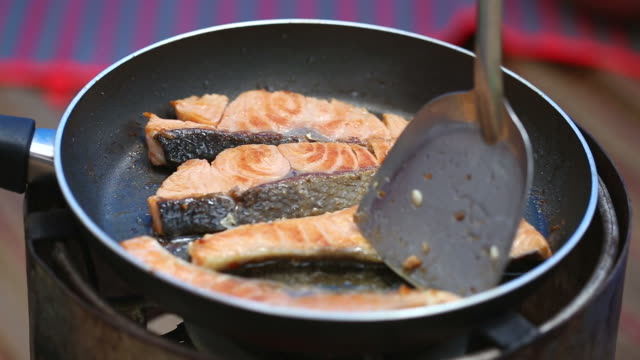 Salmon frying in pan Salmon frying in pan  fillet stock videos & royalty-free footage