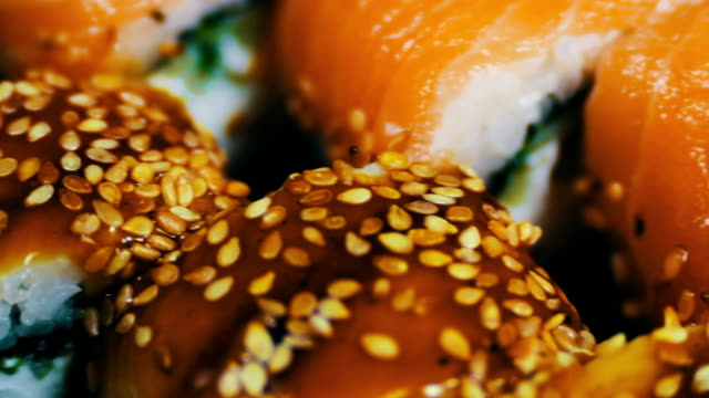 Salmon maki roll. Japanese sushi cuisine with fresh raw fish.Japanese dish consisting of rice, salmon or tuna,shrimp and fish eggs soaked in soy video