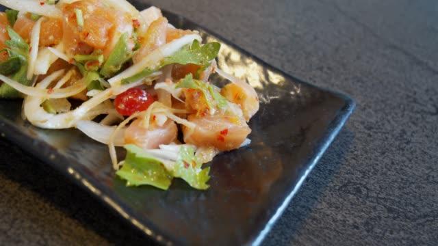 Salmon sashimi spicy salad on black dish in the restaurant.japanese food style Salmon sashimi spicy salad on black dish in the restaurant.japanese food style sashimi stock videos & royalty-free footage