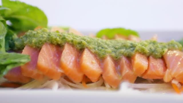 Salmon sashimi with wasabi and spicy sauce video