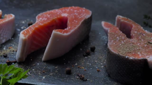 Salmon steaks seasoning video