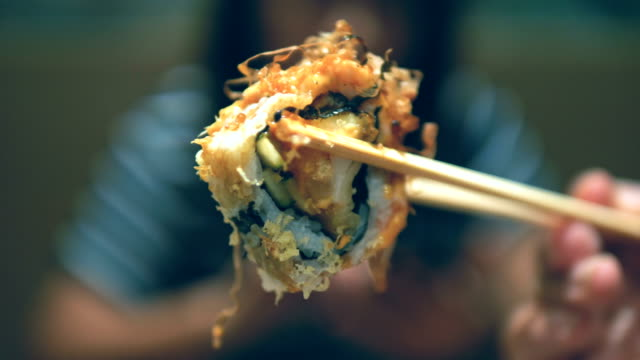 Salmon sushi roll video