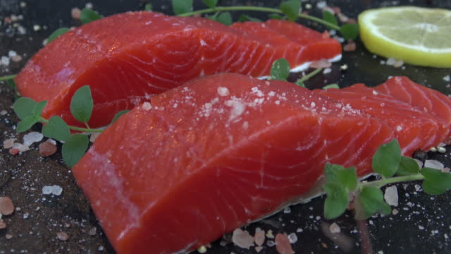 Salmon with sea salt and fresh herbs Fresh raw Sockeye salmon with sea salt and fresh herbs fillet stock videos & royalty-free footage