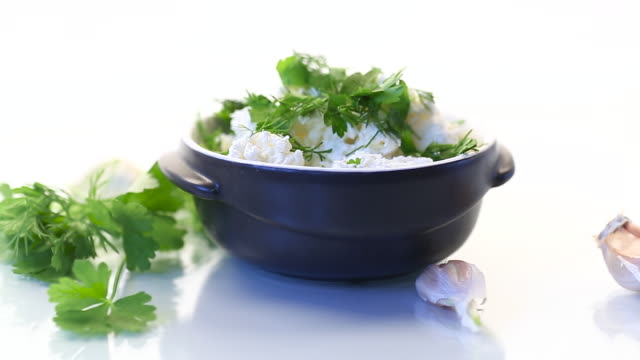 salted homemade cottage cheese with garlic and herbs in a bowl video