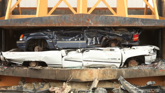 Salvage Yard Car Crusher Smashing Vehicle video