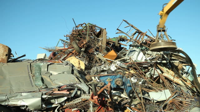 Salvage Yard Magnet Picking Up and Releasing Scrap Metal video