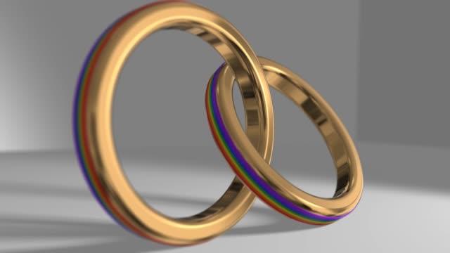 vídeos de stock, filmes e b-roll de casamento homossexual orgulho gay lgbt casamento gay casamento anel 3d render - cisgênero