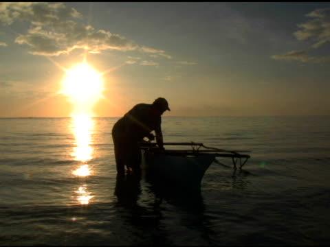Samoan fisherman, sunrise video
