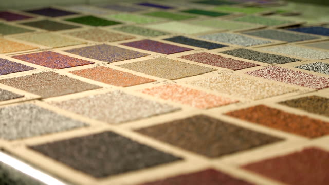 Sample color of roofing material Sample color of roofing material. Different colors of roof covering. Large palette of colors of roofing material. Sample of the color of the roofing felt is laid out on the table. Selective focus. fabric swatch stock videos & royalty-free footage