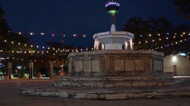 san antonio la villita fountain with tower in background at night long exposure time lapse - san antonio texas stock videos & royalty-free footage