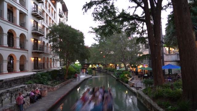 san antonio river walk view from selena bridge long exposure time lapse - san antonio texas stock videos & royalty-free footage