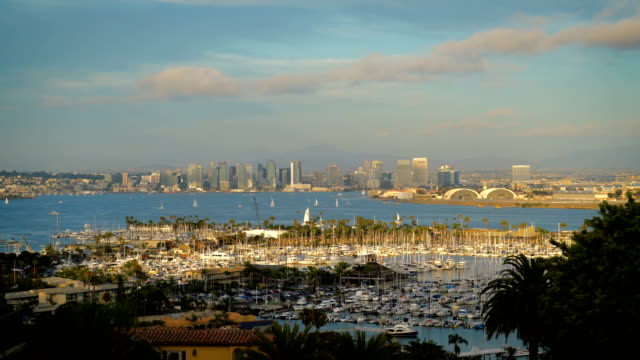 San Diego California Sunset over the entire Bay area San Diego California Sunset over the Bay looking out above Marina and Boats and entire cityscape skyline of San Diego Downtown during a perfect afternoon sunset August 2019 bay of water stock videos & royalty-free footage