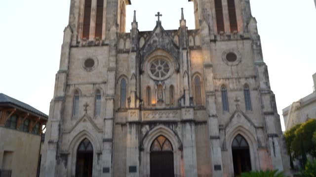 san fernando cathedral at dusk panning up to the sky - san antonio texas stock videos & royalty-free footage