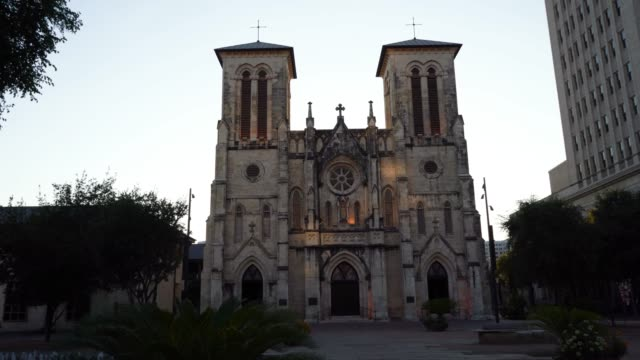 san fernando cathedral late afternoon walking towards it - san antonio texas stock videos & royalty-free footage