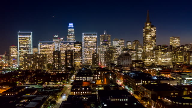 San Francisco Aerial v79 Dusk to night hyperlapse following paths of Front & Battery streets from Financial District toward Embarcadero 12/18