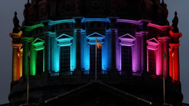 San Francisco City Hall Rainbow Pride Colors High quality 4k resolution stock video of San Francisco City Hall during  pride week in San Francisco California, lit up with rainbow colors. pride stock videos & royalty-free footage