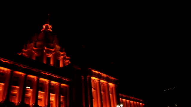 San Francisco City Hall Sequence of shots of an orange lit City Hall at night, in San Francisco California. renaissance architecture stock videos & royalty-free footage