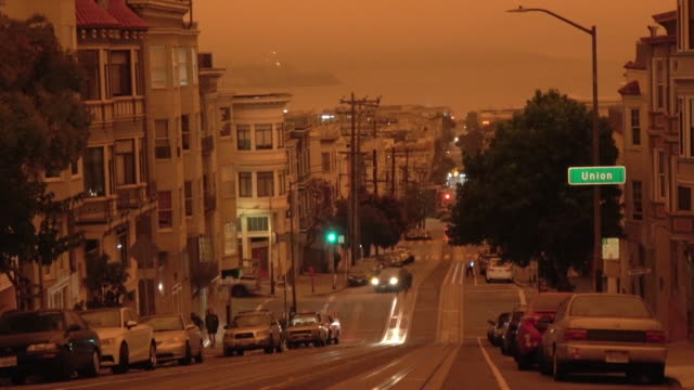 San Francisco Orange Sky During California Forest Fire A View towards Alcatraz Island as dark orange ash clouds from the surrounding forest fires covers the city. california stock videos & royalty-free footage