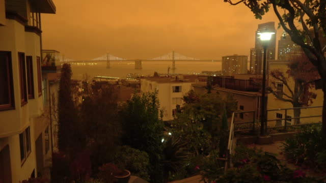 San Francisco Orange Sky During California Forest Fire A View towards Bay Bridge as dark orange ash clouds from the surrounding forest fires covers the city. california stock videos & royalty-free footage