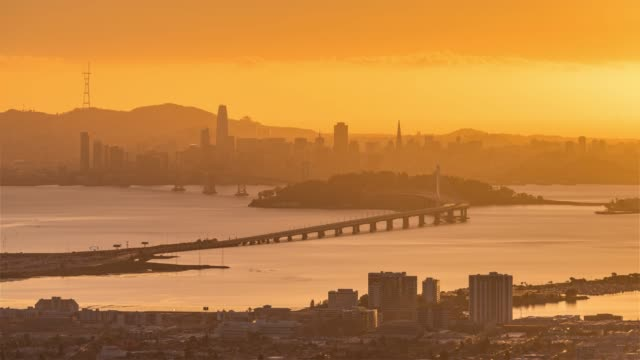 San Francisco, USA, Timelapse  - San Francisco s skyline from day to night as seen from Oakland 4K Timelapse Sequence of San Francisco, USA - San Francisco s skyline from day to night as seen from Oakland oakland stock videos & royalty-free footage