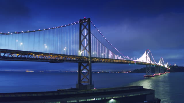 San Francisco-Oakland Bay Bridge Lit Up at Night - Drone Shot