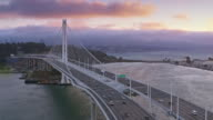 istock AERIAL San Francisco-Oakland Bay Bridge towards the Yerba Buena Island at sunset 1014389518