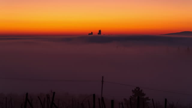 San Gimignano, Tuscany - Sunrise Time Lapse Time lapse of San Gimignano at Dawn with fog surrounding the city italian architecture stock videos & royalty-free footage