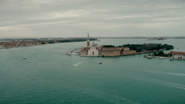 San Giorgio Maggiore church aerial drone view. Tourist boats sail near the church of San Giorgio Maggiore. View from above of the church of San Giorgio Maggiore. Island of San Giorgio Maggiore. video