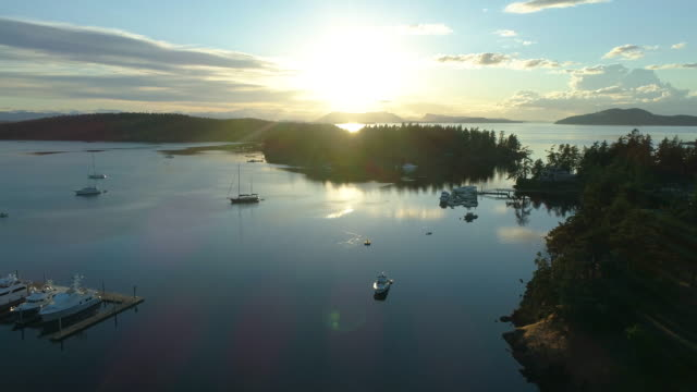San Juan Island Sunset Aerial Birds Eye View of Roche Harbor San Juan Island Sunset Aerial Birds Eye View of Roche Harbor Looking Toward Sidney Island and Victoria BC jetty stock videos & royalty-free footage