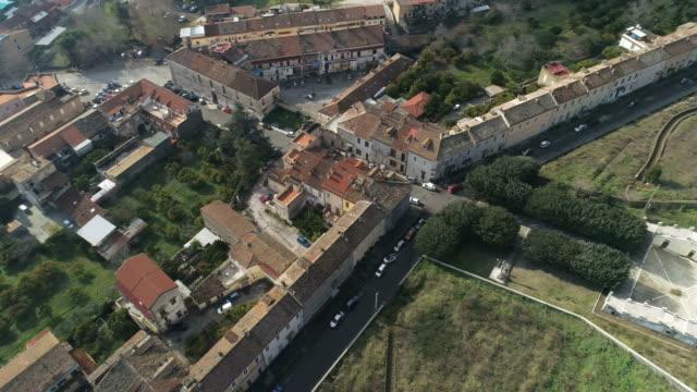 San Leucio Aerial view of San Leucio, an UNESCO World Heritage Site, part of 18th century Royal Palace at Caserta. Caserta Municipality. Campania. Italy. palace stock videos & royalty-free footage