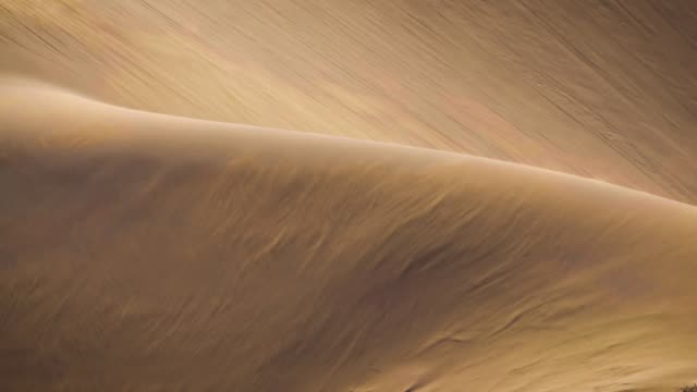 Sand blowing over the dunes, SlowMotion video