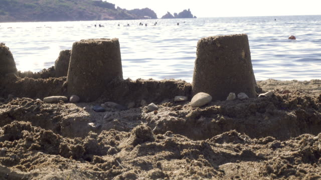 Sand castle built on beach