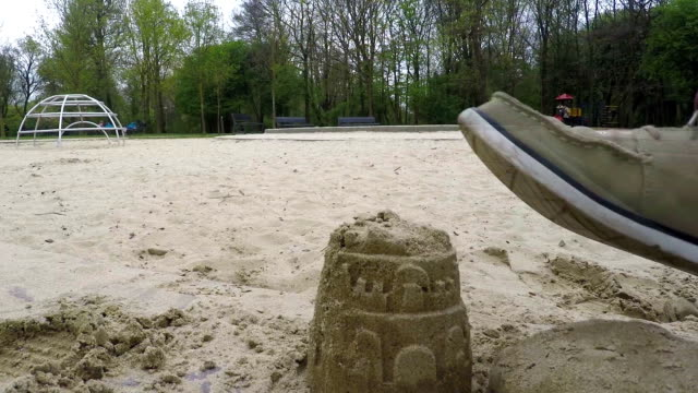Sand Castle Destroyed By Shoes In Children's Park This is footage of a child park with a sand castle in it. A man steps on it with his shoes on. stamping feet stock videos & royalty-free footage