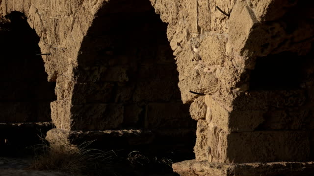 Sand Dunes Against Ancient Roman Aqueduct Israel, Caesarea - Ocean, Aqueduct aqueduct stock videos & royalty-free footage