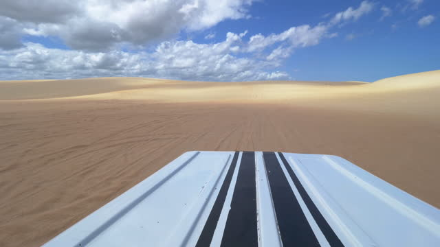 Sand Dunes Buggy adventure in Jericoacoara, Fortaleza, Ceara, Brazil Wide angle from de buggy roof, POV of the adventure in the sand dunes. natal stock videos & royalty-free footage