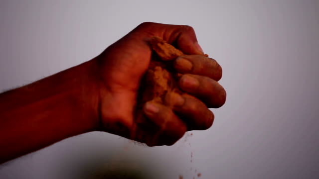 Sand in hands Human hand picking sand & dropping it down. haryana stock videos & royalty-free footage
