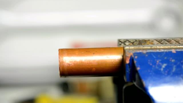 Sanding a copper pipe Sanding a copper pipe  pipefitter videos stock videos & royalty-free footage