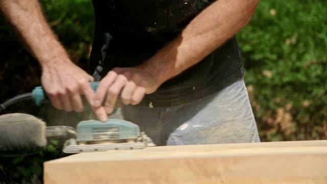 Sanding a wooden door