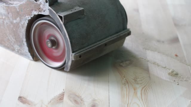 sanding a wooden floor with a grinder - levigatrice video stock e b–roll