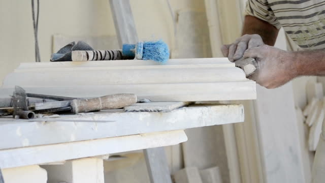 sanding and shaping limestone decoration video